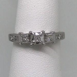 .33 ctw princess & round diamonds 14 kt WG setting